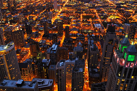 This is a stock photo. A city overview of Chicago, Illinois at night.