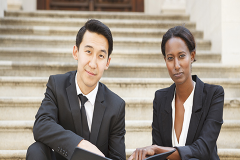 This is a stock photo. Two young business professionals.